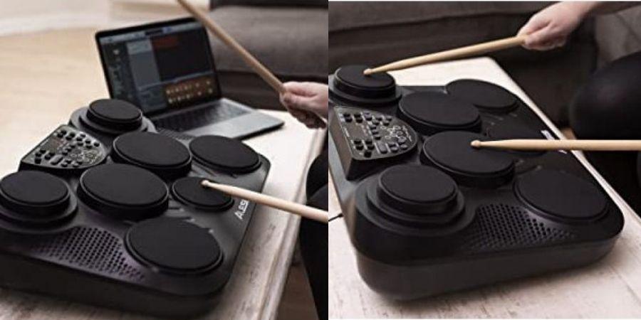 tambor musical compact kit de mesa tocando con baquetas